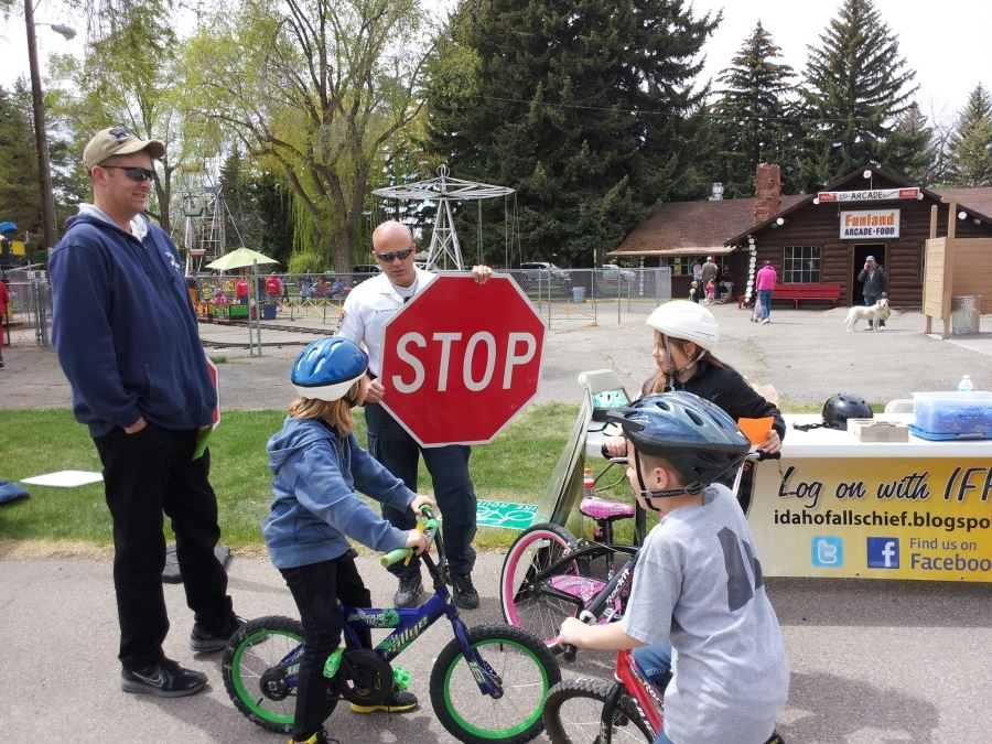 Officer Harkness teaches a group of children about bicycle safety
