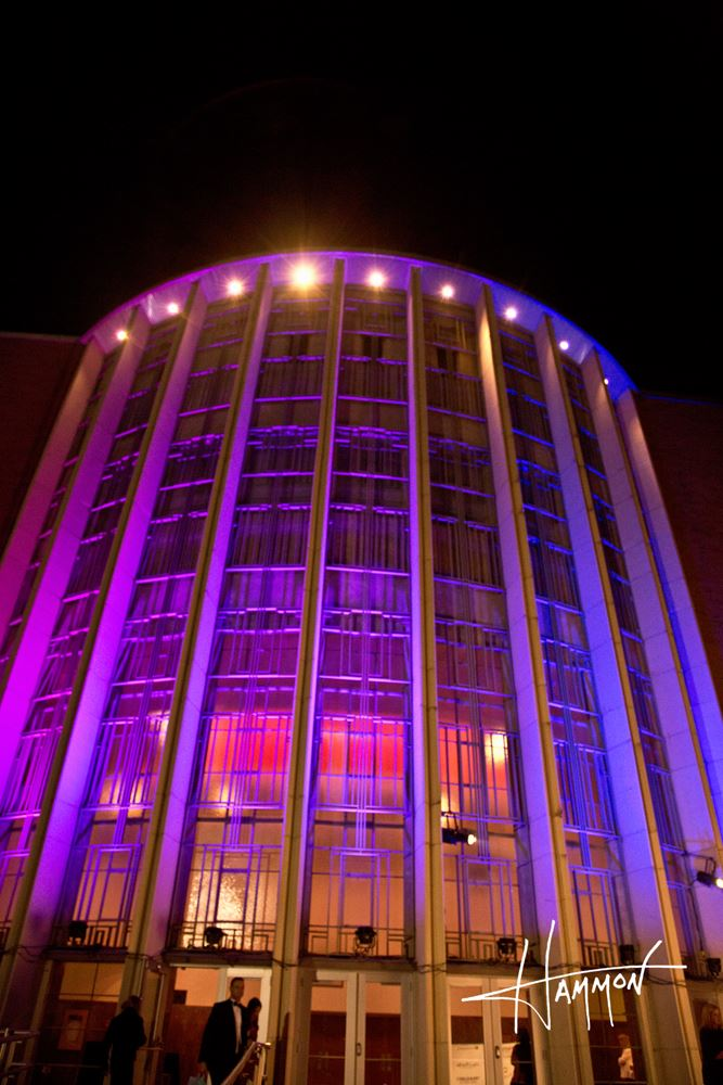 A close up of the Civic Auditorium in pink lights.