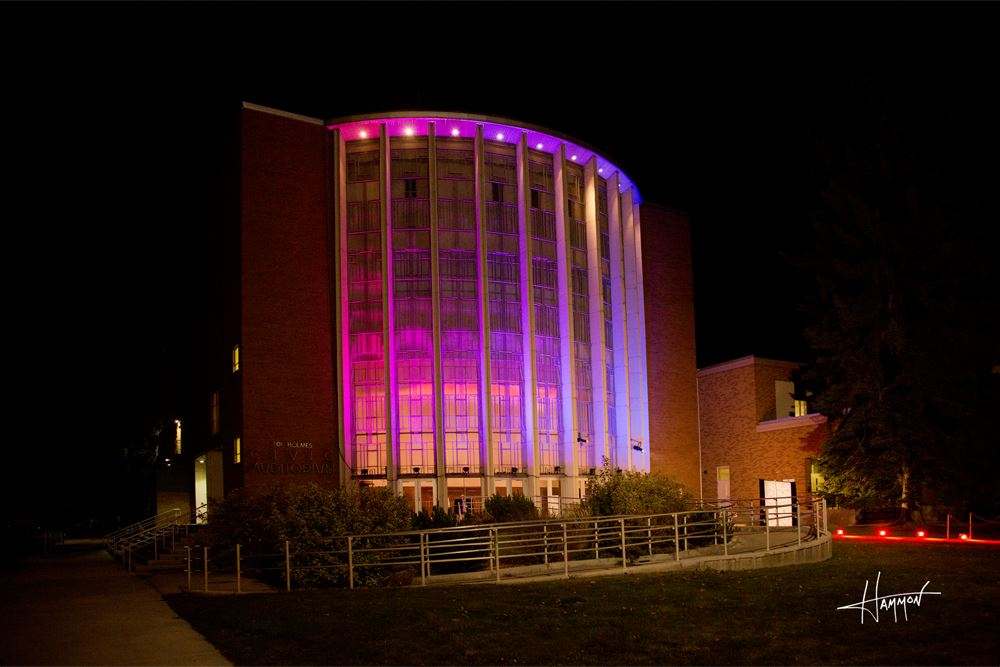 The side of Civic Auditorium lit up in pink.