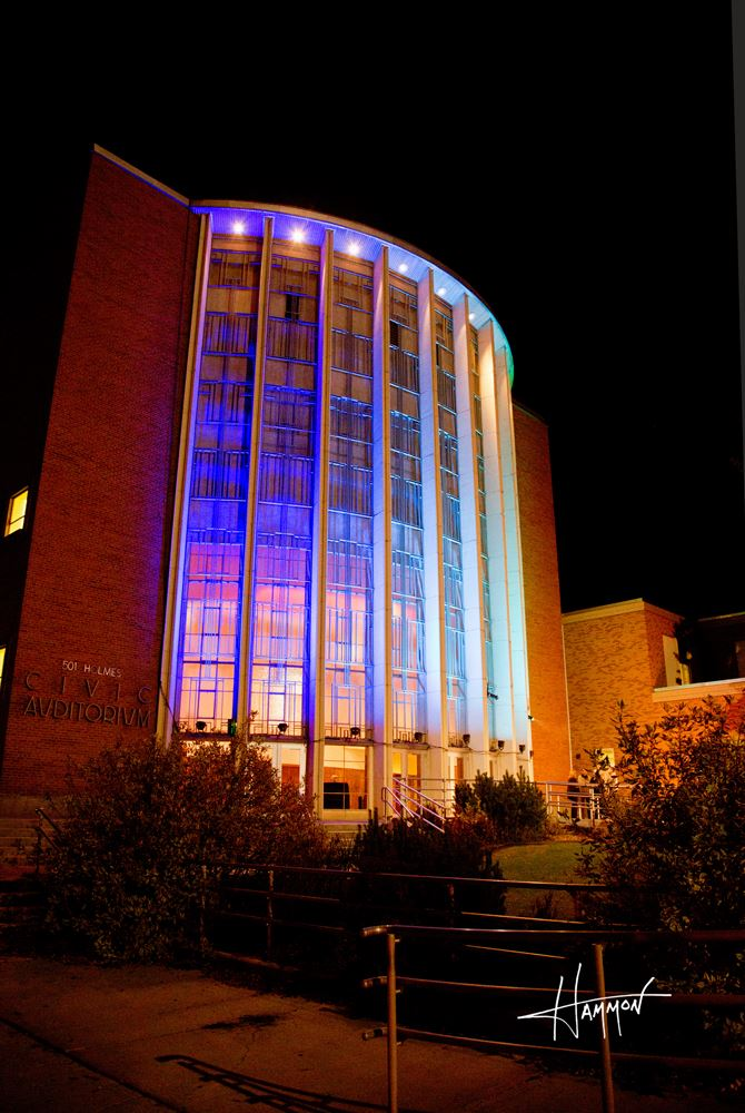 The side of Civic Auditorium lit up in blue.